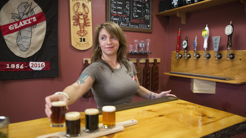 Craft breweries now account for 5,234 of 5,301 U.S. beer makers, according to an industry group's annual tally. Here, Danielle Coons, the tasting room ambassador at D.L. Geary Brewing Co. serves a beer in Portland, Maine, last November. Brianna Soukup/Portland Press Herald via Getty Images
